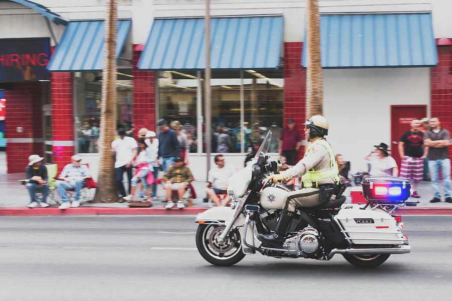 Motorcycle Cop In Motion by SR Green