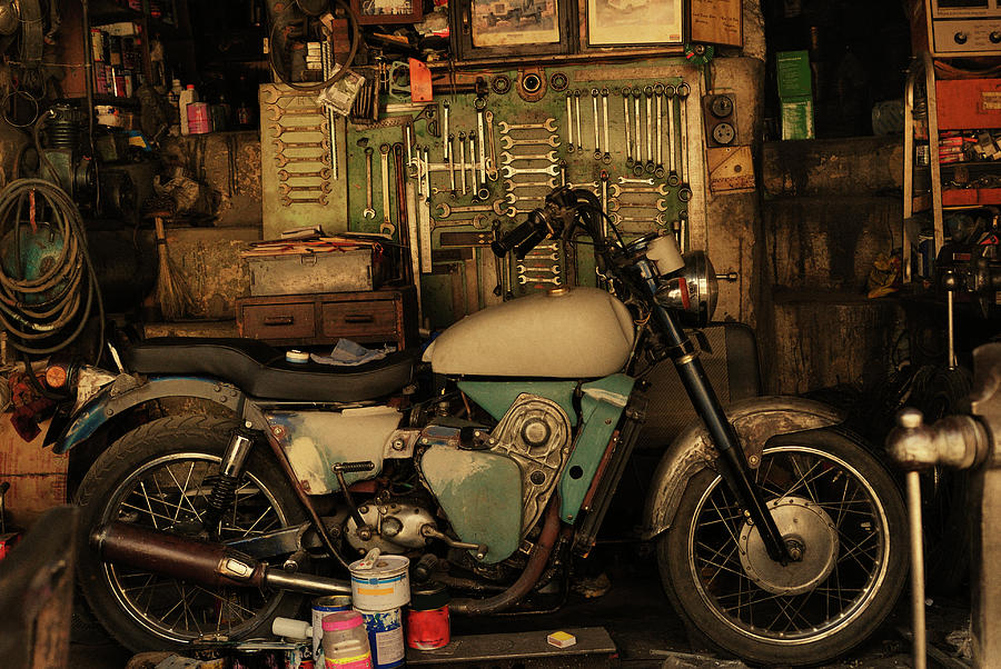 Motorcycle In An Auto Repair Shop Photograph by Win-initiative/neleman