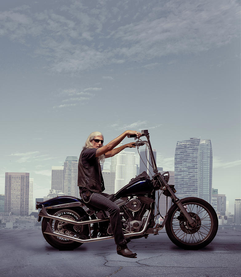 Motorcycle Rider With City Background Photograph by Ed Freeman