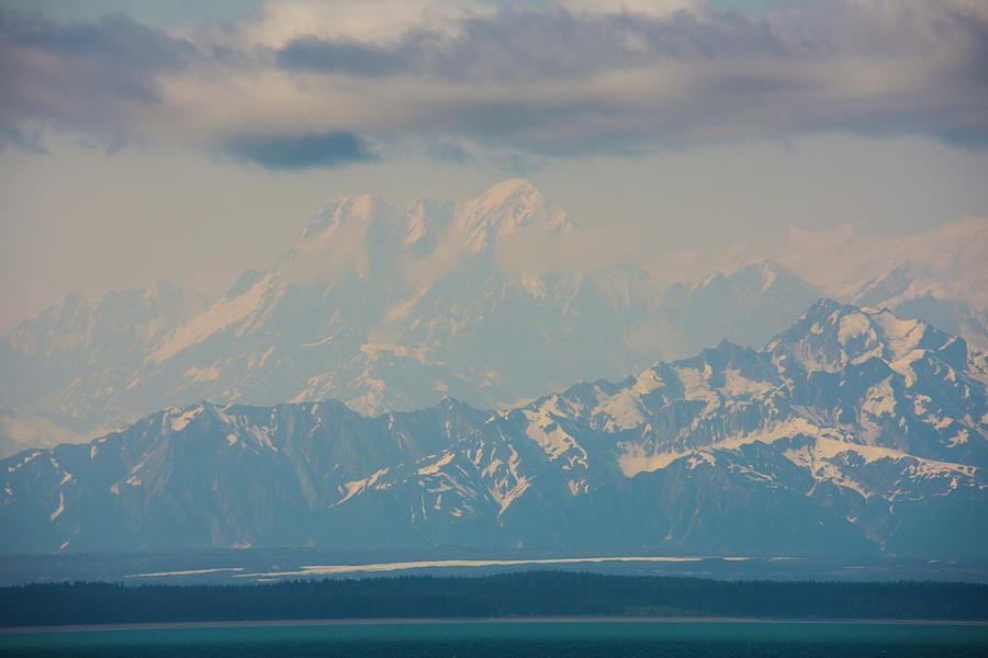 Mount Saint Elias in clouds by Yulia Kazansky