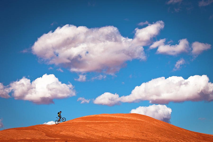 Mountain Biker Climbing On Slick Rock Photograph by Visualcommunications