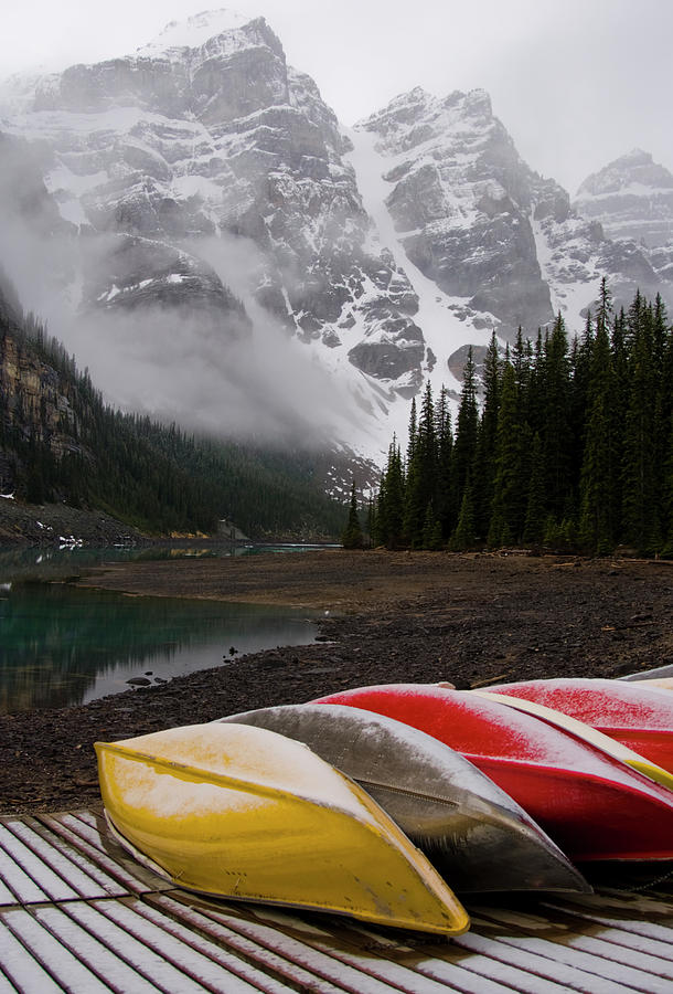 Mountain Lake And Canoes Photograph by Dorin s