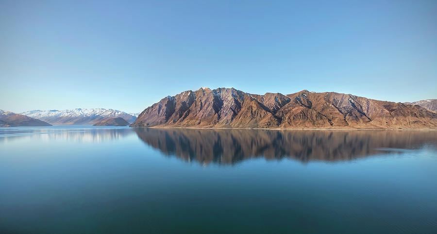 Mountain Reflected On Lake Hawea Photograph by Verity E. Milligan