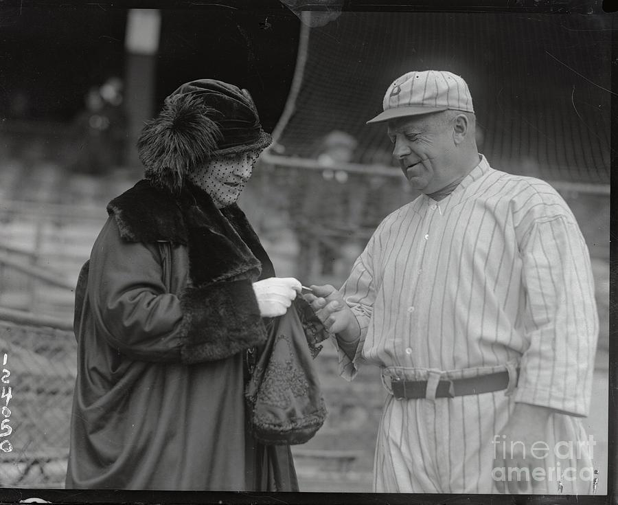 Mrs. Wilbert Robinson Gives Husband Photograph by Bettmann