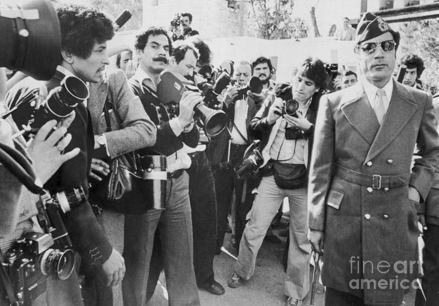 Muammar Al-qaddafi Passing Photographers Photograph by Bettmann