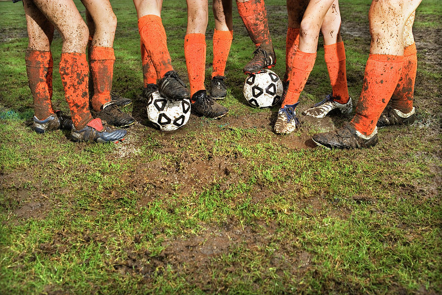 Muddy Legs Of Soccer Players Photograph by Jupiterimages