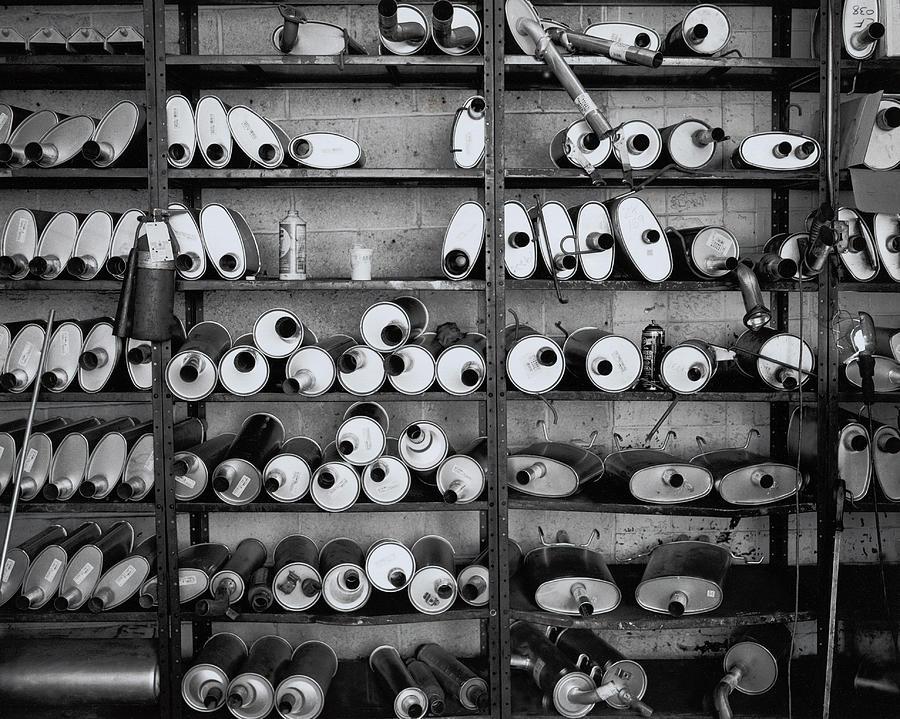 Mufflers On Shelves Photograph by Henri Silberman