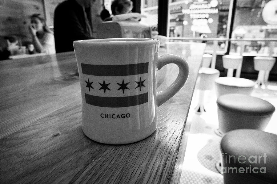 Chicago Photograph - mug of coffee with the chicago flag in stans donuts in wicker park Chicago IL USA by Joe Fox