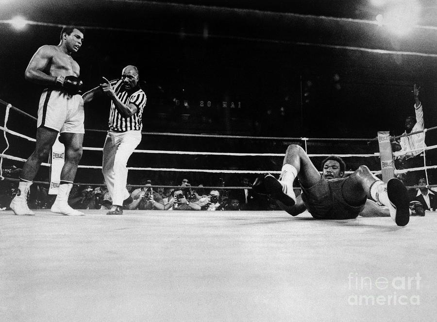 Muhammad Ali Knocks George Foreman Onto Photograph by Bettmann