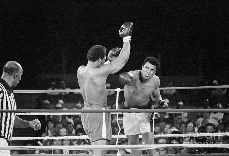 Muhammad Ali Punching George Foreman Photograph by Bettmann