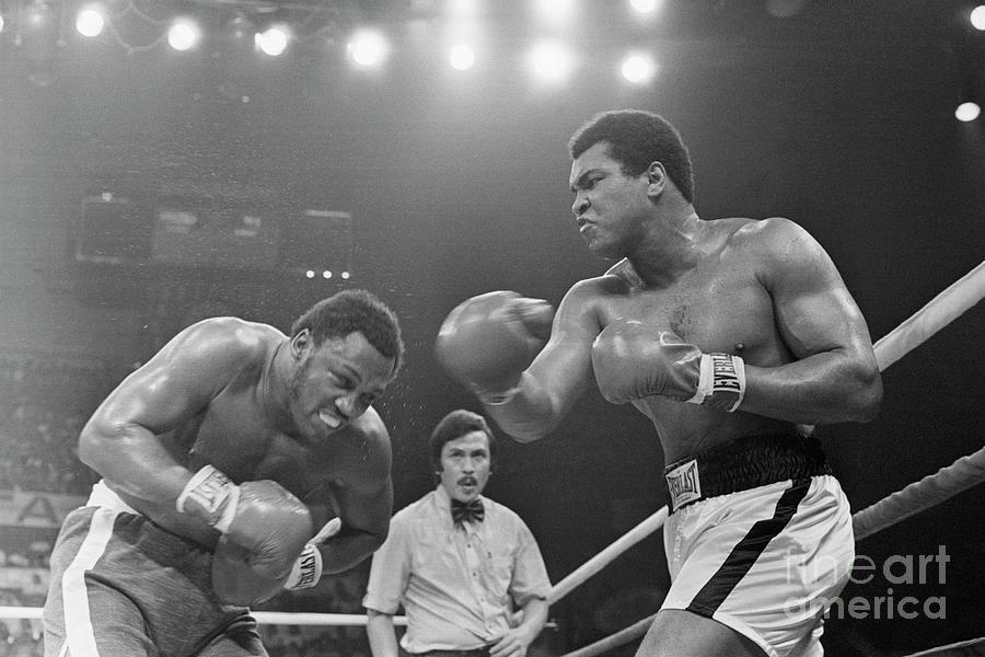 Muhammad Ali Punching Joe Frazier Photograph by Bettmann