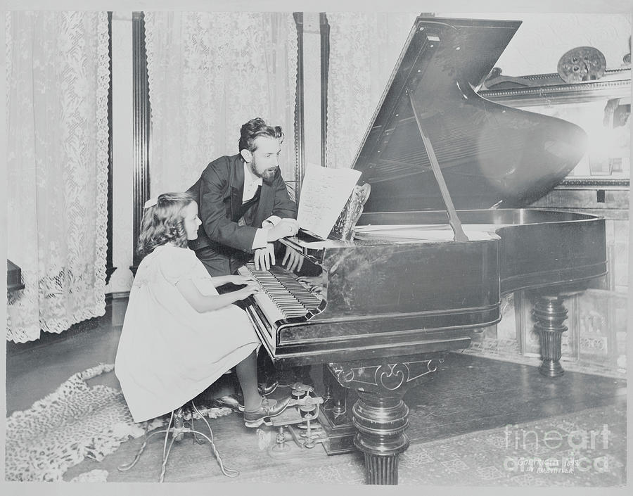 Music Teacher With Student At The Piano Photograph by Bettmann