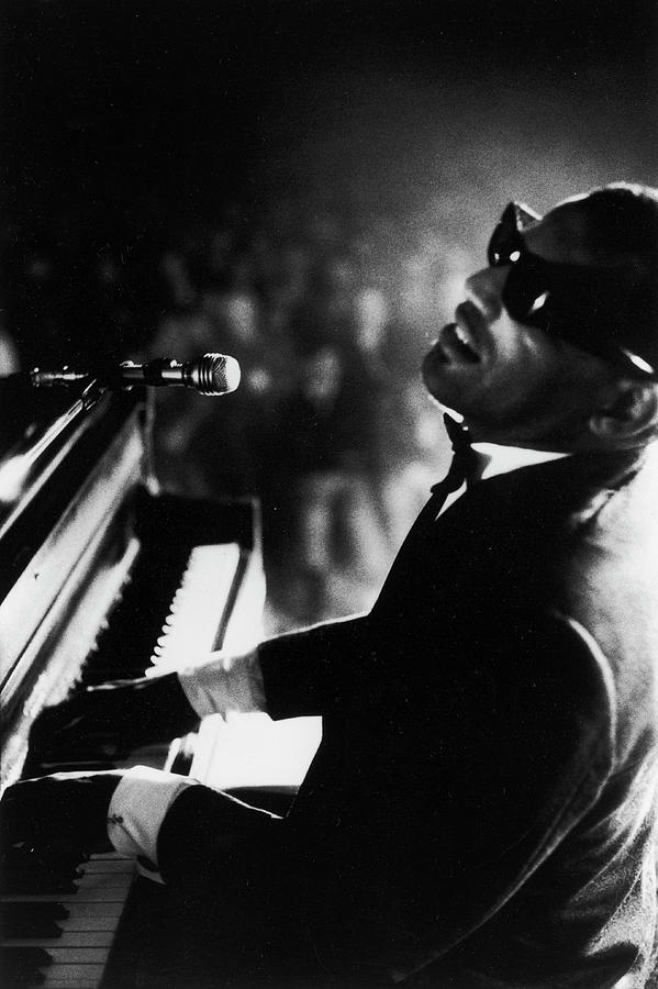 Musician Ray Charles Playing Piano In Photograph by Bill Ray