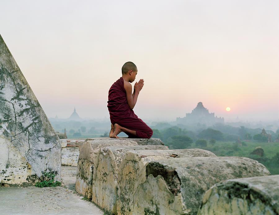 Myanmar, Bagan, Buddhist Monk Praying Photograph by Martin Puddy