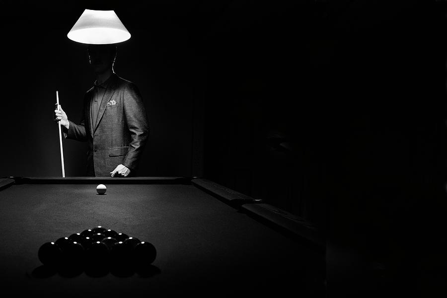 Mystery Pool Player Behind Rack Of Photograph by Design Pics / Richard Wear