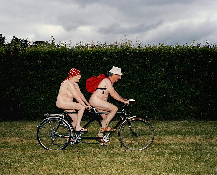 Naked Mature Couple Riding Tandem Photograph by Chris Craymer