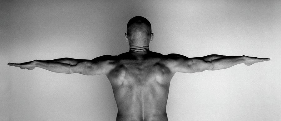 Naked Muscluar Man Standing With Arms Photograph by Isabella Wirth