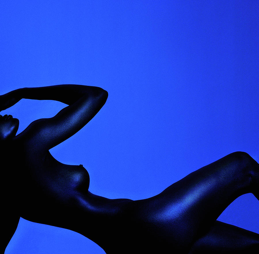 Naked Woman Lying Down Against Blue Photograph by Adri Berger