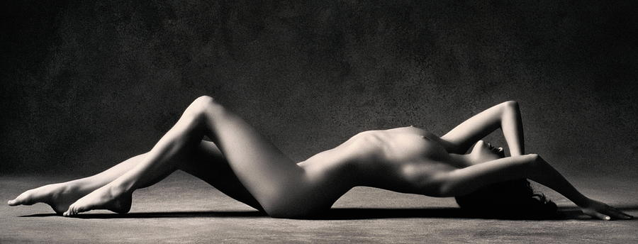 Naked Woman Lying On Floor, Knees Bent Photograph by Stuart Mcclymont