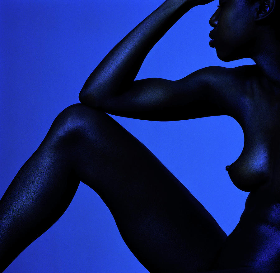 Naked Woman Sitting Against Blue Photograph by Adri Berger
