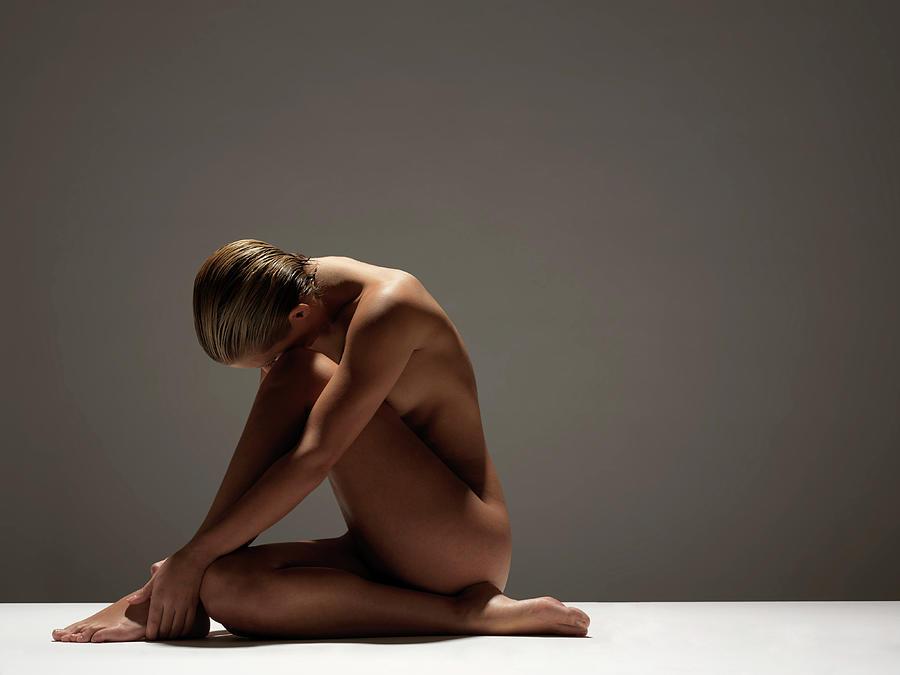 Naked Woman Sitting Photograph by John Lamb
