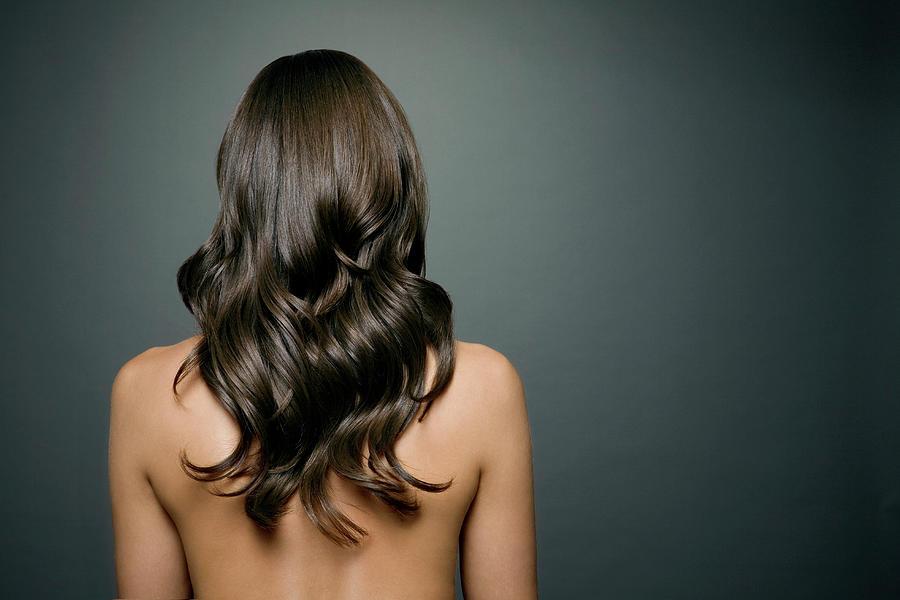 Naked Woman With Long Shiny Wavy Hair Photograph by Andreas Kuehn