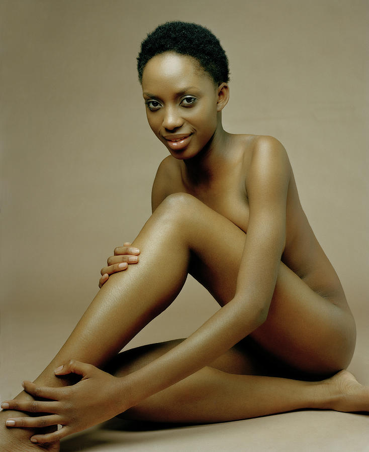 Naked Young Woman Sitting With Thigh Photograph by Andreas Kuehn