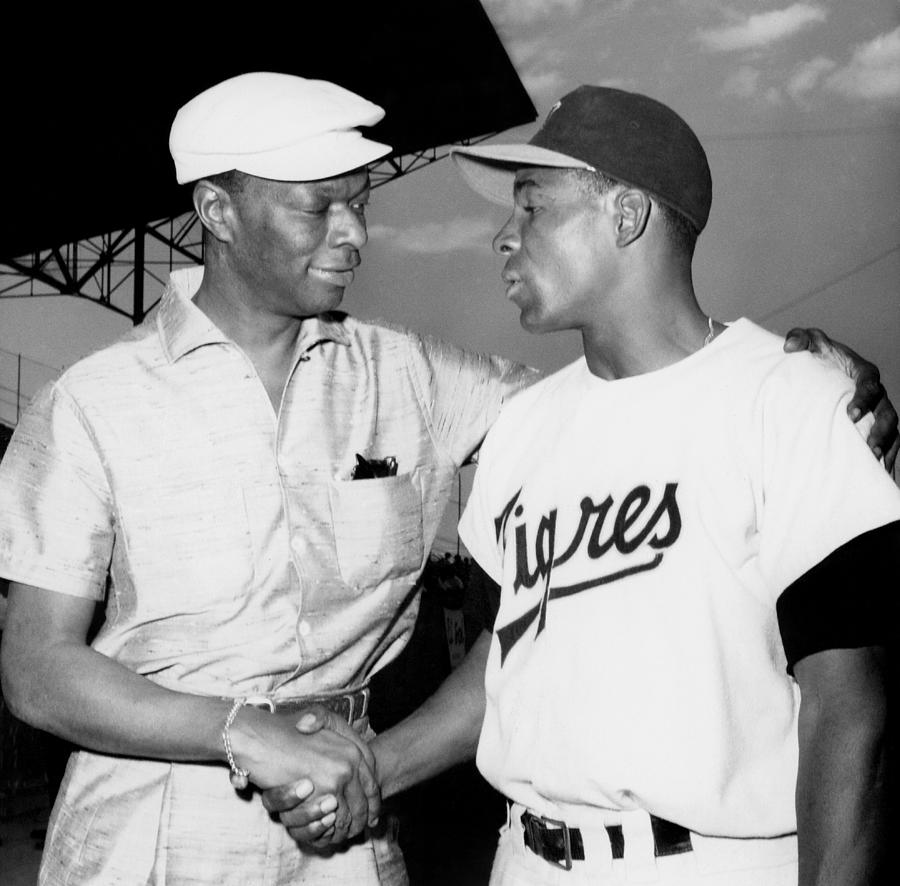 Nat King Cole And Minnie Minoso Photograph by Michael Ochs Archives