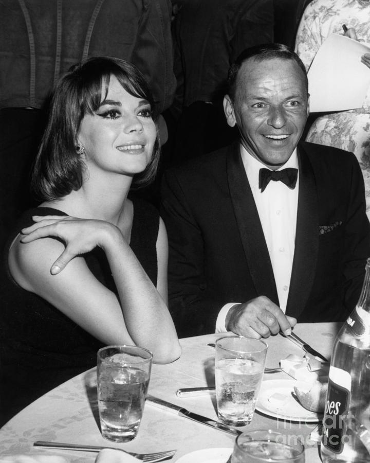 Natalie Wood And Frank Sinatra Dining Photograph by Bettmann
