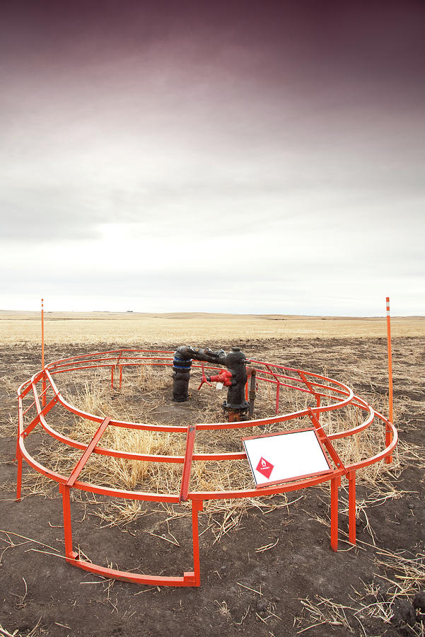 Natural Gas Wellhead In Oil Field Photograph by Imaginegolf