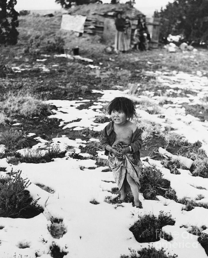 Navajo Toddler Standing On Snowy Ground Photograph by Bettmann