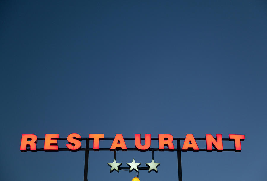 Neon 3 Star Restaurant Sign Photograph by Henglein And Steets