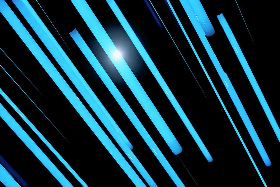 Neon Blue Rods Of Glowing Light Photograph by Ralf Hiemisch