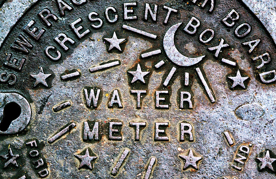 Lids Photograph - New Orleans Water Meter Cover by John Rizzuto