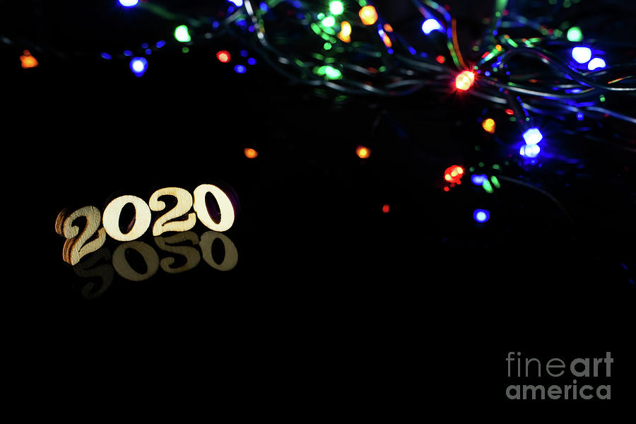 New Year 2020 With Numbers And Bright Lights On Dark Background Photograph By Joaquin Corbalan