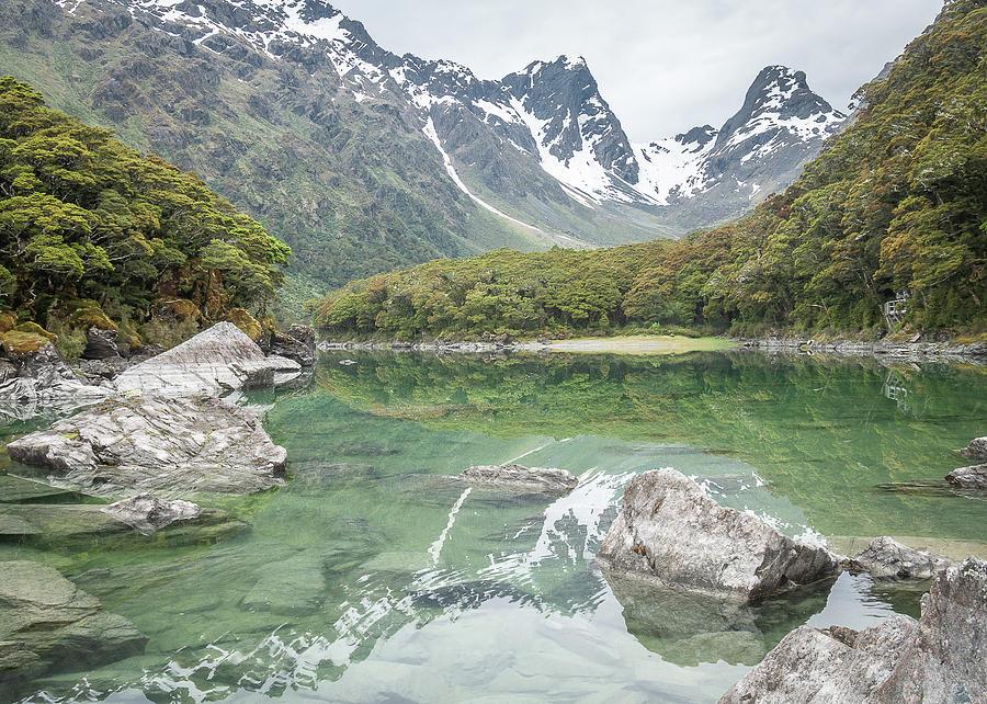 Pristine Alpine Lake With Mountain Backdrop In New Zealand  by Peter Kolejak