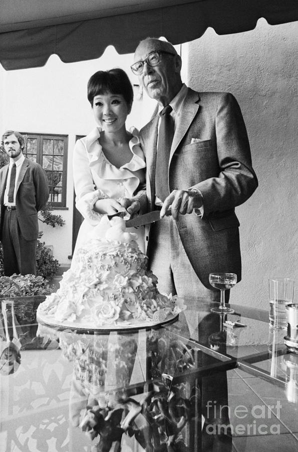 Newlyweds Cutting Wedding Cake Photograph by Bettmann