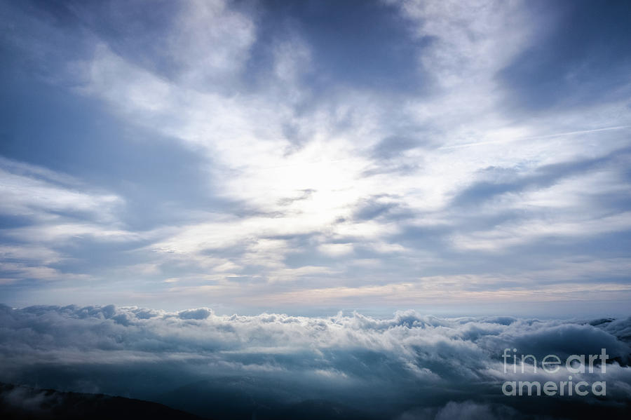 Nice image as a background of cloudy sky in high mountains for nature background. by Joaquin Corbalan