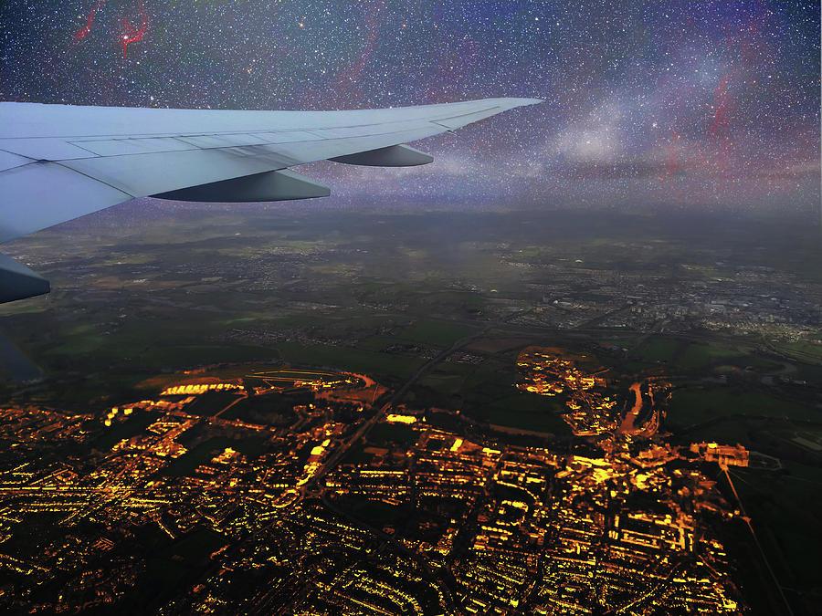 Night Flight Over City Lights by Jason Fink
