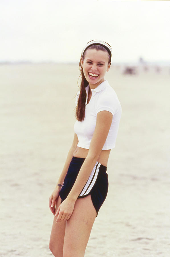 53511c5d54 Niki Taylor In Adidas Shorts On The Beach Photograph by Arthur Elgort