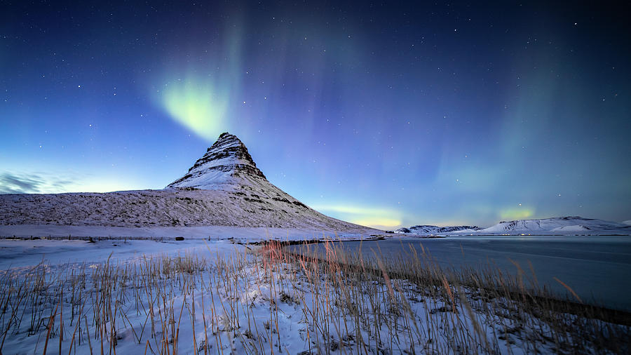 Northern Lights Atop Kirkjufell Iceland by Nathan Bush