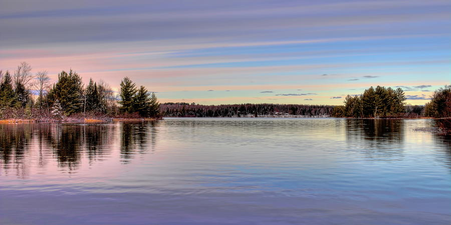 November Clouds Over Dam Lake by Dale Kauzlaric