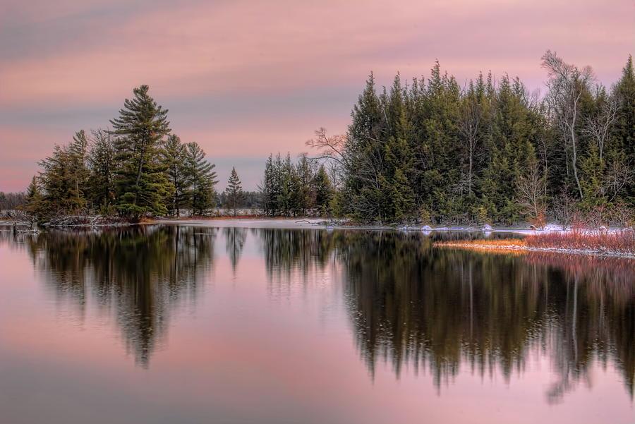 November Clouds Over Sand Lake by Dale Kauzlaric