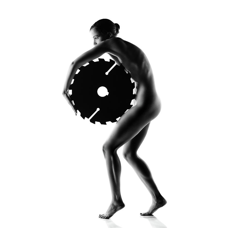 Woman Photograph - Nude woman with saw blade 1 by Johan Swanepoel