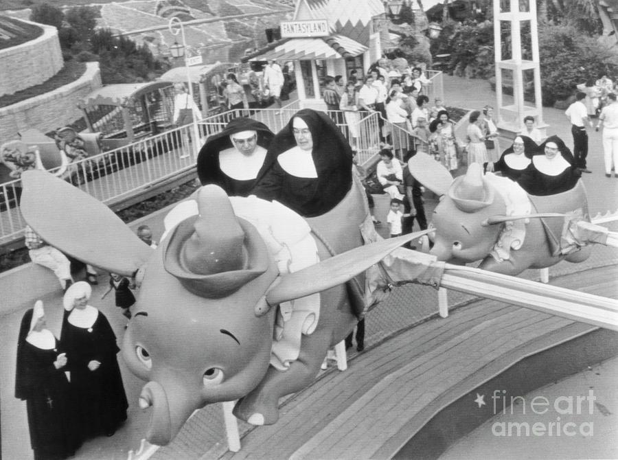 Nuns On Dumbo Ride Photograph by Bettmann