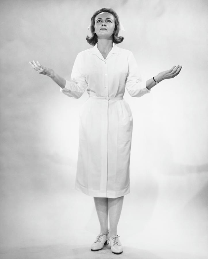Nurse Gesturing In Studio, B&w Photograph by George Marks