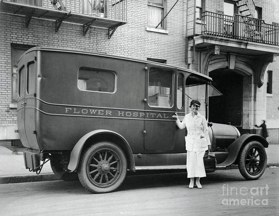 Nurse Standing By Flower Hospital Photograph by Bettmann