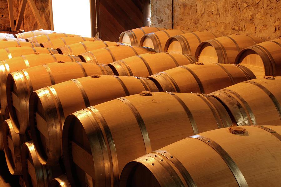 Oak Wine Barrel Rows In Winery Cellar Photograph by Yinyang