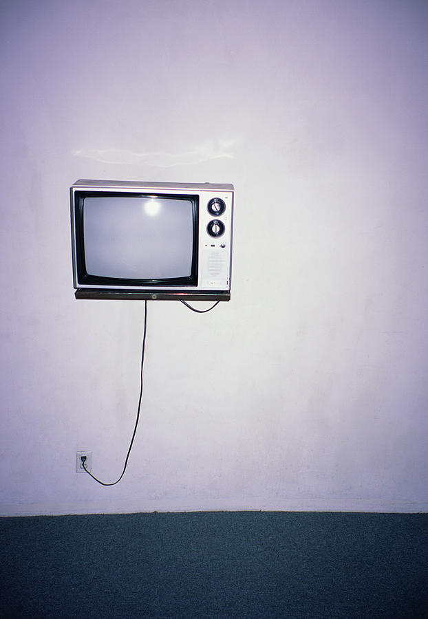 Obsolete Tv Hanging On A Motel Wall Photograph by Pete Starman