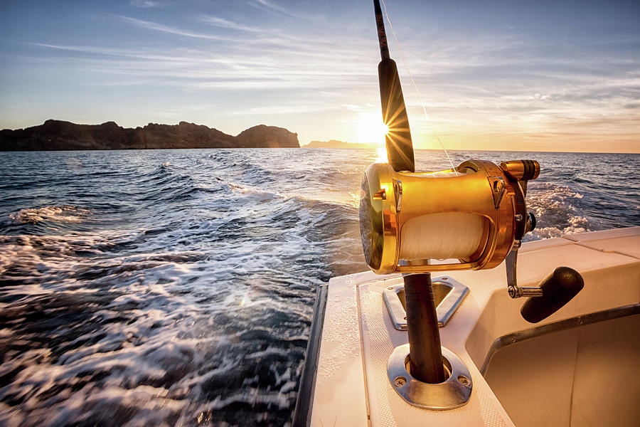 Ocean Fishing Reel On A Boat In The Photograph by Grandriver